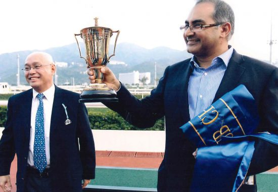 Giresh Melwani collecting the trophy for the Chinese Club Challenge Cup 2012